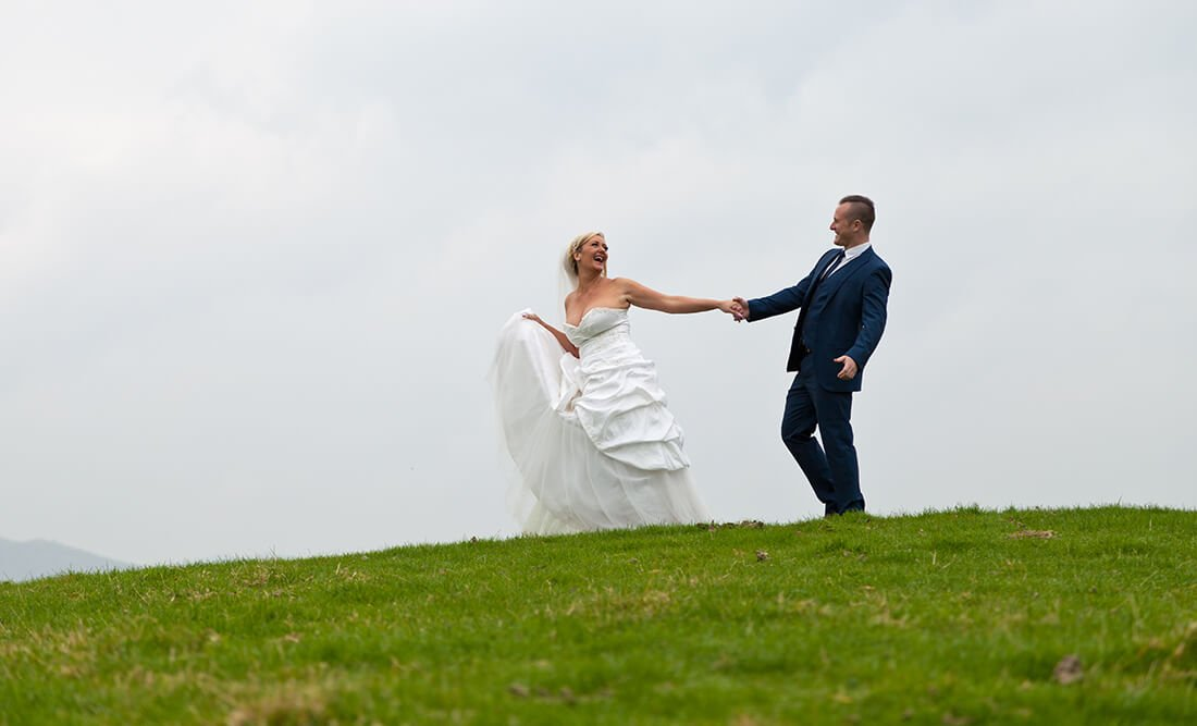 wedding couple on hill