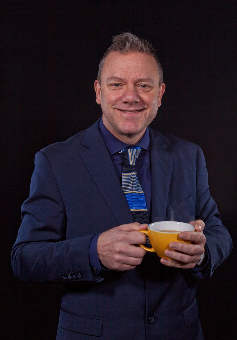 male portrait  headshot with cup of coffee